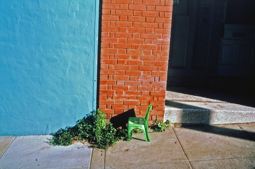 image from Left Behind series: small green plastic chair on the sidewalk