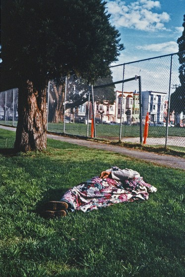 image from Left Behind series: man sleeping in a blanket on the grass