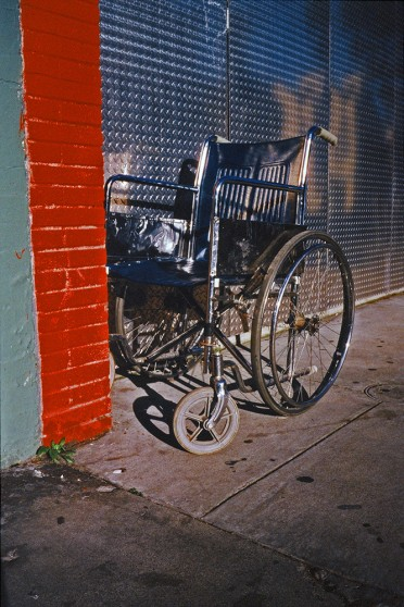 image from Left Behind series: wheelchair left on the street