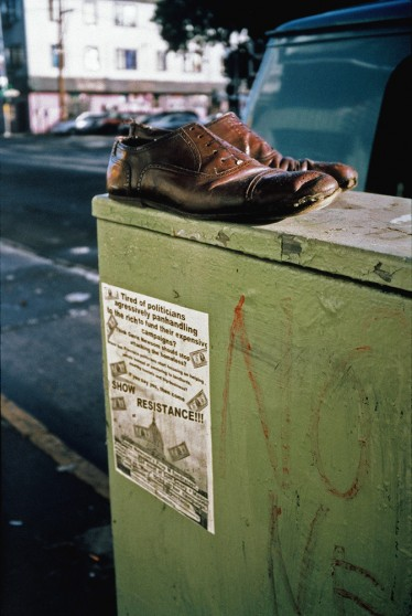 image from Left Behind series: worn shoes over a sign that says Show Resistance